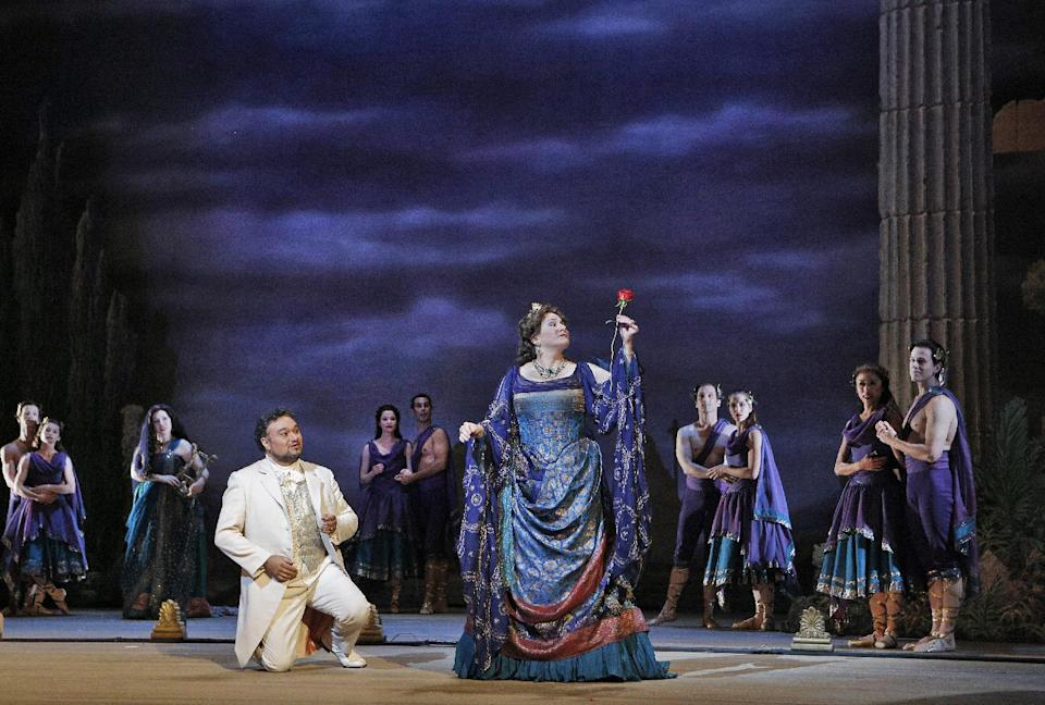 "This undated publicity photo provided by the San Francisco Opera shows Ramón Vargas, left, as Faust and Patricia Racette as Elena in Act IV during the dress rehearsal of ""Mefistofele,"" in San Francisco. (AP Photo/Copyright San Francisco Opera, Cory Weaver)"