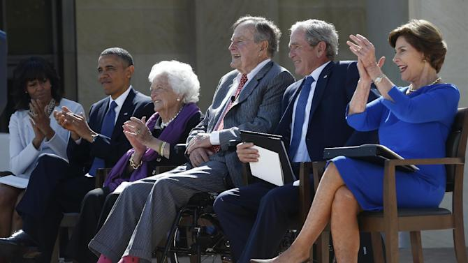From left, President Barack Obama, first lady Michelle Obama, former first lady Barbara Bush, former Presidents George H.W. Bush, George W. Bush, and former first lady Laura Bush take part in the dedication of the George W. Bush presidential library on the campus of Southern Methodist University in Dallas, Thursday, April 25, 2013. (AP Photo/Charles Dharapak)