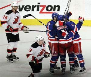 Lundqvist, Kreider lift NYR over Devils in opener