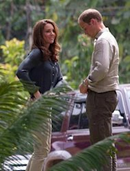 "<p>Britain's Prince William and Catherine, the Duchess of Cambridge, arrive at the Borneo Rainforest Research Center in Danum Valley, on the island of Borneo on September 15. The British royal family have warned an Italian magazine that ""unjustifiable upset"" would be heaped on Catherine if it went ahead and printed topless photos of her.</p>"