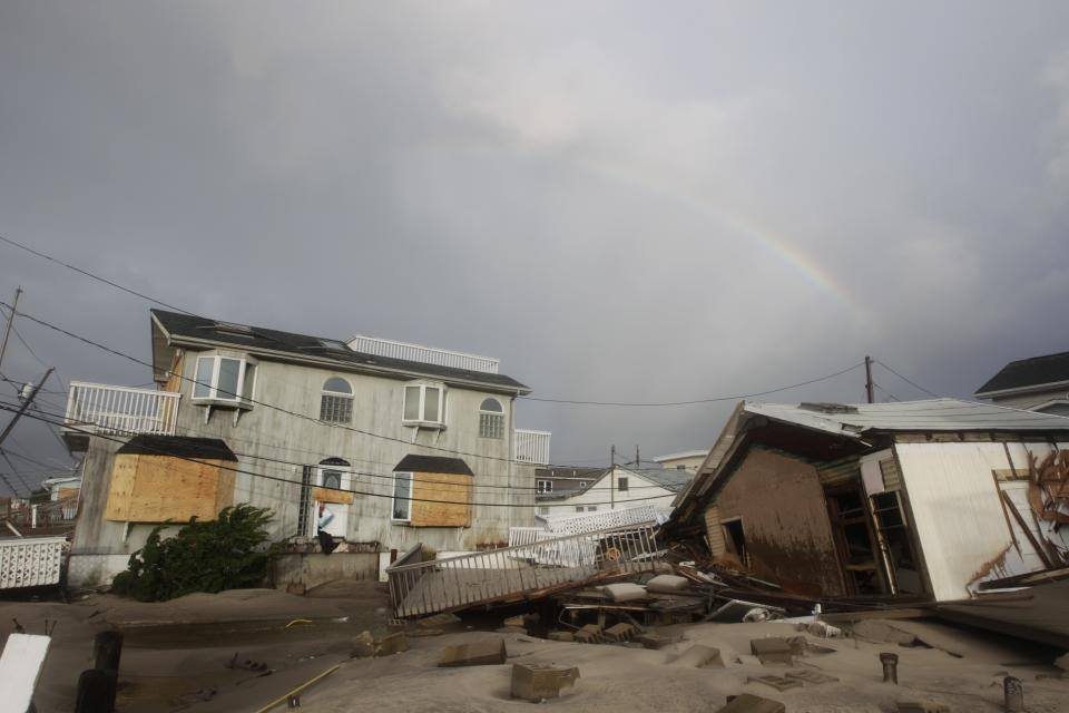 Damage from flooding at Breezy Point after superstorm Sandy Tuesday, Oct. 30, 2012, in the New York City borough of Queens.The fire destroyed between 80 and 100 houses Monday night in the flooded neighborhood. (AP Photo/Frank Franklin II)