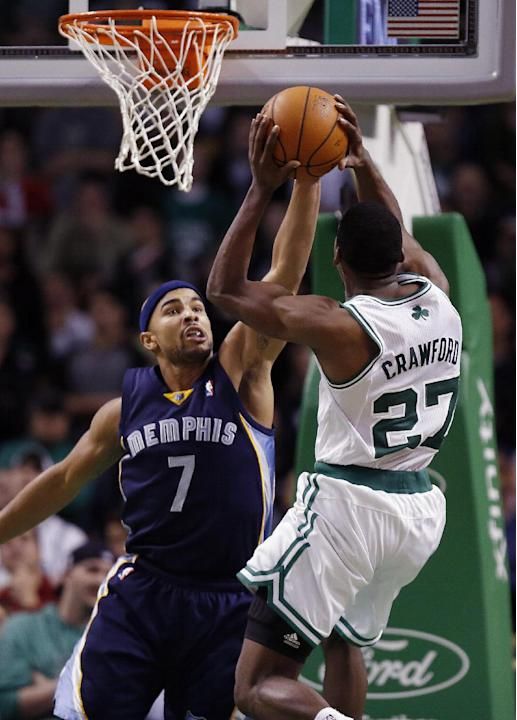 Memphis Grizzlies' Jerryd Bayless (7) blocks a shot by Boston Celtics' Jordan Crawford (27) in the fourth quarter of an NBA basketball game in Boston, Wednesday, Nov. 27, 2013. The Grizzlies won 100-9