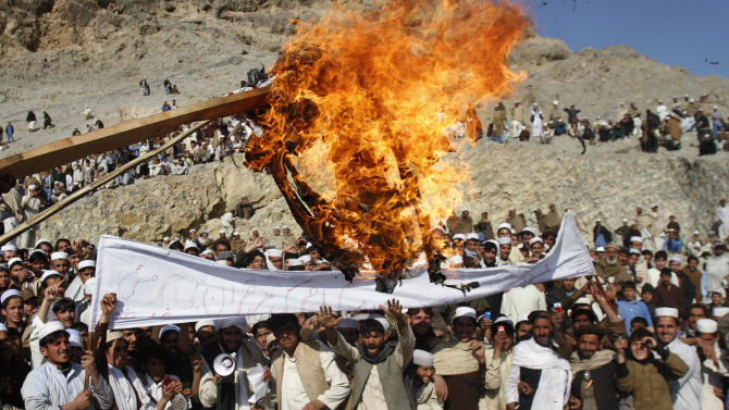 Afghans burn an effigy representing the US President Barack Obama during anti-US protest over burning of Qurans at a military bass in Afghanistan, in Ghani Khail, east of Kabul Friday, Feb. 24,2012. (AP Photo/Rahmat Gul)
