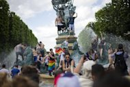 People participate in the Gay Pride parade in Paris on June 30. France's new Socialist government is to legalise marriage and adoption for same-sex couples, Prime Minister Jean-Marc Ayrault said on June 29