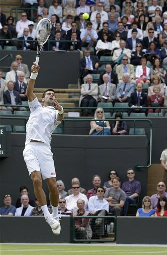 Federer, Djokovic set up semifinal at Wimbledon