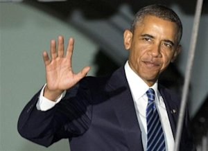 U.S. President Obama waves as he walks to Marine One at the White House in Washington