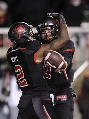Dunn's 2 100-yard returns lift Utah 49-27 over Cal