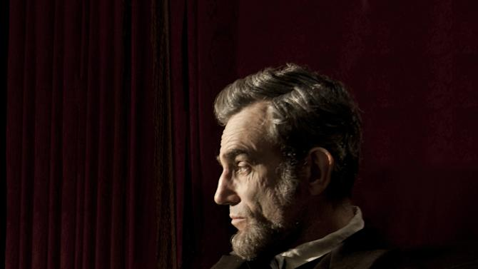 """FILE - This publicity film image released by DreamWorks and Twentieth Century Fox shows Daniel Day-Lewis portraying Abraham Lincoln in the film """"Lincoln.""""  From the campaign of """"Lincoln,"""" the Steven Spielberg-directed film backed by The Walt Disney Co., critics say they've received no less than four coffee table books, an intricately framed DVD for review purposes and even a hand-signed letter from Spielberg himself, thanking them for recognizing the film with so many nominations. (AP Photo/DreamWorks, Twentieth Century Fox, David James, file)"""