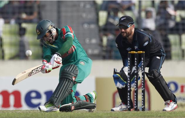 Bangladesh's captain Mushfiqur Rahim plays a shot as New Zealand's wicket keeper Brendon McCullum watches during their first ODI cricket match in Dhaka