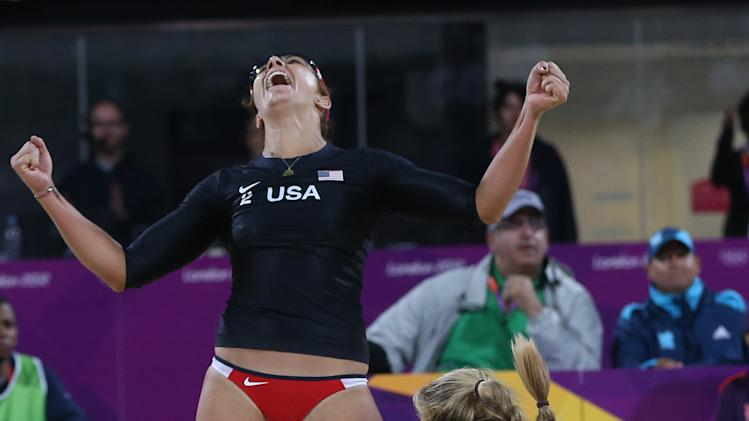 Misty May-Treanor, left, and Kerri Walsh, right, of US celebrate after defeating Australia in their Beach Volleyball match at the 2012 Summer Olympics, Saturday, July 28, 2012, in London. (AP Photo/Petr David Josek)