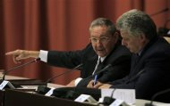 "Cuba's President Raul Castro (L) addresses the audience next to newly elected First Vice President Miguel Diaz-Canel during the closing session of the Cuban National Assembly in Havana February 24, 2013. Castro announced on Sunday he would step down from power after his second term as president ends in 2018, and the new parliament named a 52-year-old rising star to become his first vice president and most visible successor. Castro, 81, made the announcement in a nationally broadcast speech shortly after the Cuban National Assembly elected him to a second five-year term in the opening session of the new parliament. ""This will be my last term,"" Castro said. REUTERS/Enrique De La Osa"