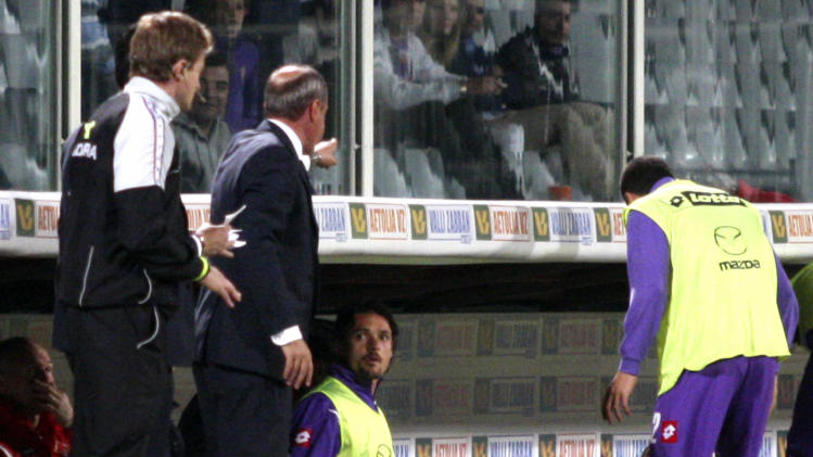 In this Wednesday, May 2, 2012 photo Fiorentina coach Delio Rossi, second from left, gestures at Serbia's Adem Ljajic, second from right, sitting on the bench, during a Serie A soccer match between Fiorentina and Novara, at the Artemio Franchi stadium in Florence, Italy. Fiorentina coach Delio Rossi's physical assault of one of his own players, Adem Ljajic, sparked outrage Thursday, and the club announced that club manager Vincenzo Guerini will take over the team for the final two matches of the season. Rossi was fired for slapping Adem Ljajic in the face after the Serbian forward protested his first-half substitution Wednesday during a 2-2 draw with Novara. The coach then had to be pulled away as it appeared he was lining up a punch. (AP Photo/Photobovo, Lapresse)