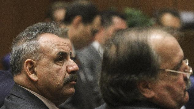 FILE - In this photo taken Wednesday, Feb. 20, 2013 file photo, former Bell, Calif. mayor Oscar Hernandez, left, and defendant Victor Bello, right listens to closing arguments in a massive city corruption trial in a downtown Los Angeles courtroom. Hernandez, the unschooled and illiterate former mayor of the scandal-ridden suburban city of Bell had no training that would have alerted him that his huge salary was illegal, his lawyer told a jury in closing arguments. (AP Photo/Los Angeles Times, Irfan Khan, Pool)