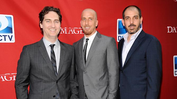 """FILE - This June 28, 2012 file photo shows creators and executive producers Daniel Zelman, left, Todd Kessler and Glenn Kessler, right, attending the """"Damages"""" season five premiere at the Paris Theater in New York. """"Damages,"""" starring Glenn Close and Rose Byrne, returns Wednesday at 9 p.m. EDT on DirecTV. (Photo by Evan Agostini/Invision/AP, file)"""