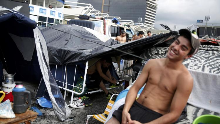 An Argentina fan relaxes at a tent and motorhome park amongst others waiting out for Sunday's World Cup final between Argentina and Germany at the Terreirao do Samba in Rio de Janeiro