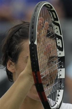 Schiavone fights off match points to beat Begu
