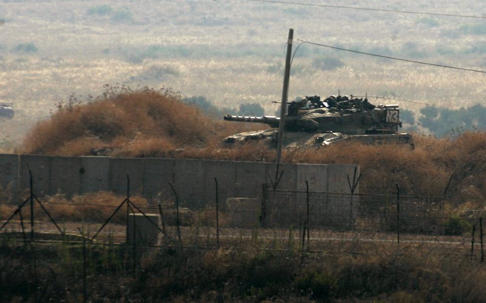 An Israeli tank patrols the border with Lebanon, seen from the southeastern Wazzani River area, Lebanon, Monday, Aug. 1, 2011. Israeli and Lebanese troops briefly exchanged fire Monday on the countries' border, a volatile area where tensions can easily reignite hostilities between the two nations. (AP Photo/Lutfallah Daher)