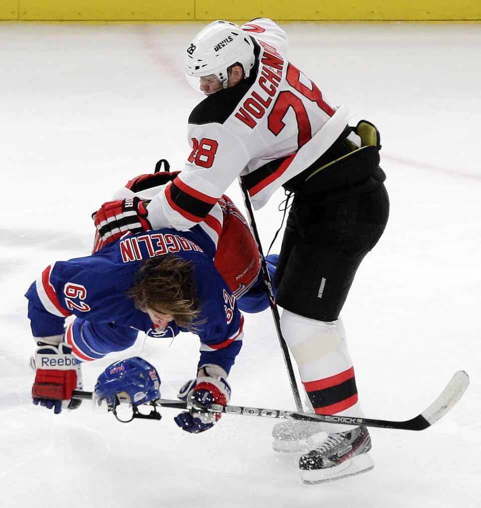 New Jersey Devils' Anton Volchenkov (28) and New York Rangers' Carl Hagelin (62) collide during the second period of Game 2 of the NHL hockey Stanley Cup Eastern Conference final playoff series, Wednesday, May 16, 2012, in New York. (AP Photo/Frank Franklin II)