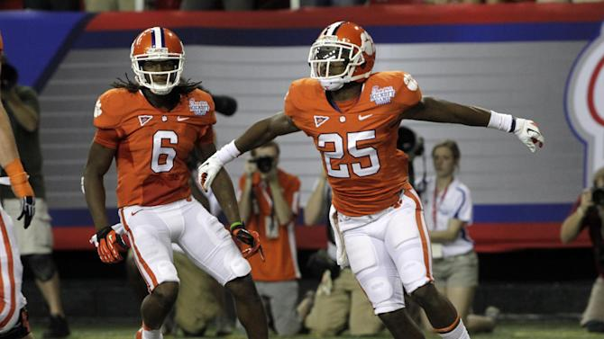 Clemson running back Roderick McDowell (25) reacts after scoring a touchdown against Auburn in the second quarter of a NCAA college football game at the Georgia Dome in Atlanta Saturday, Sept. 1, 2012.  At left is Clemson wide receiver DeAndre Hopkins (6). (AP Photo/Dave Martin)