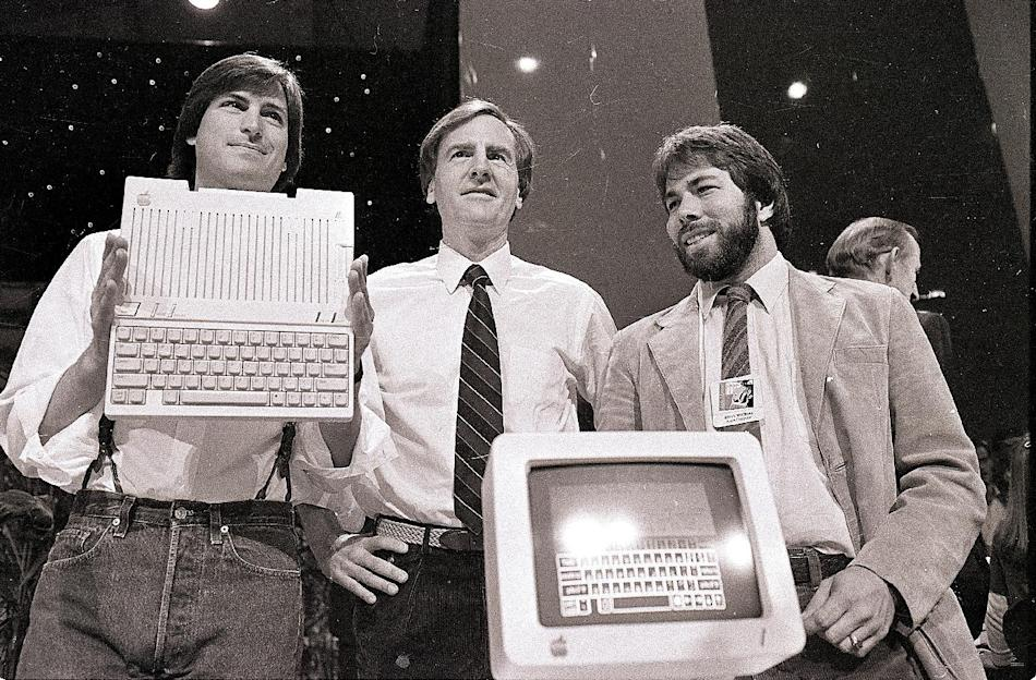 1984 - From left, Steve Jobs, chairman of Apple Computers, John Sculley, president and CEO, and Steve Wozniak, co-founder of Apple, unveil the new Apple IIc computer in San Francisco. Apple on Wednesd