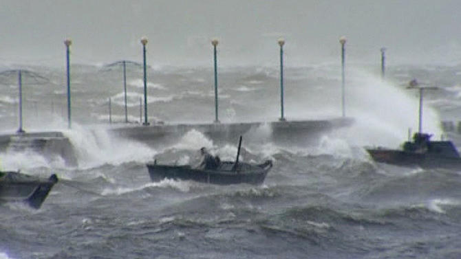 In this image made off North Korea's Korean Central News Agency video footage, a person rides on a small boat in the rough seas off Wonsan City in Kangwon Province, North Korea, as a typhoon hits the area on Tuesday, Aug. 28, 2012. A second typhoon in less than a week is approaching North Korea on Thursday, threatening more rain in a country where storms often mean catastrophe because of deforestation and fragile infrastructure. (AP Photo/Korean Central News Agency)