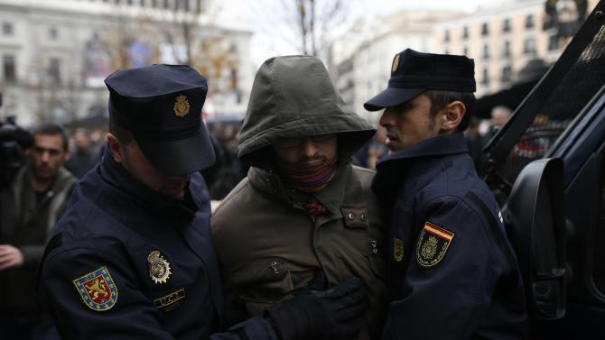 "A demonstrator is detained following a demonstration demanding the release of several anarchists and against the so-called ""Ley Mordaza"" in downtown Madrid"