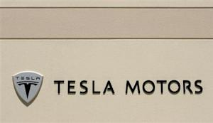 The logo for Tesla Motors is shown at the company headquarters in San Carlos