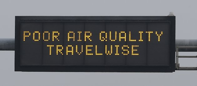 A poor air quality warning is posted over a highway Wednesday, Jan. 23, 2013, in Salt Lake City.  A group of doctors is declaring a health emergency over northern Utah's lingering pollution problem. U