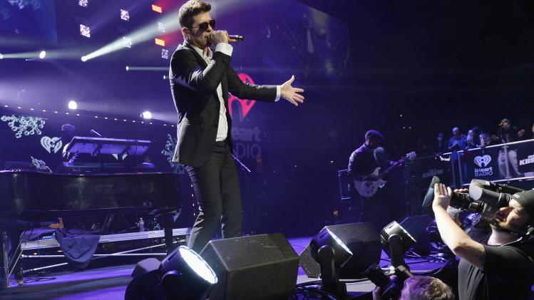 Robin Thicke performs during KIIS FM's Jingle Ball concert at the Staples Center in Los Angeles
