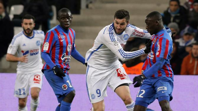 Olympique Marseille's Gignac challenges Caen's Appiah during their French Ligue 1 soccer match at the Velodrome stadium in Marseille