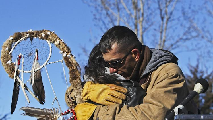 "Peter Lengkeek, The Dakota Wokiksuye 38 + 2 Memorial Ride staff keeper, right, hugs Perry Little, after Lengkeek had picked Little as the new staff keeper during the ceremony at Reconciliation Park Wednesday, Dec. 26, 2012, in Mankato, Minn. The annual ride commemorates the 38 + 2 Dakota warriors hanged following the Dakota War of 1862. The ""Dakota 38"" Memorial lists the names of all the Dakota warriors hanged in 1862. (AP Photo/The Star Tribune, David Joles)"