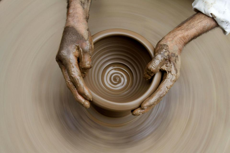 A Kashmiri potter makes earthen pots at his home on the outskirts of Srinagar, India, Sunday, April 22, 2012. April 22 is observed as Earth Day every year as a tool to raise ecological awareness.(AP Photo/Mukhtar Khan)
