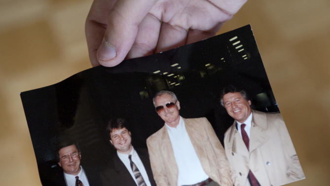 Peter Gamlen holds a photograph of actor Paul Newman that he found in a suit discarded in the basement of his apartment in New Haven, Conn., Tuesday, Oct. 9, 2012. Gamlen believes the suit belonged to Newman. (AP Photo/Jessica Hill)