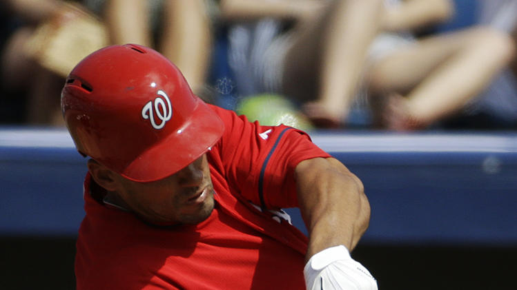 Washington Nationals' Ian Desmond plays in an exhibition spring training baseball game against the New York Yankees, Tuesday, March 11, 2014, in Viera, Fla. (AP Photo/David Goldman)