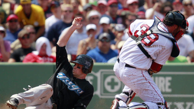 Toronto Blue Jays' Aaron Hill, is safe at home plate as Boston Red Sox's Jarrod Saltalamacchia (39) gets the late throw in the third inning of a baseball game in Boston, Monday, July 4, 2011. (AP Photo/Michael Dwyer)