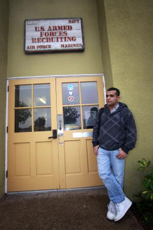 Former United States Marine Will Rodriguez, who was forced out of the Marine Corp and has been denied re-enlistment,  stands outside a Armed Forces recruiting office, Tuesday, Oct. 19, 2010, in San Diego.  (AP Photo/Lenny Ignelzi)