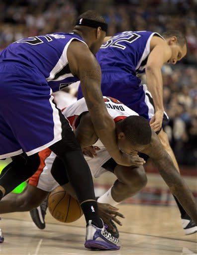Cousins scores 31, Kings beat Raptors 105-96