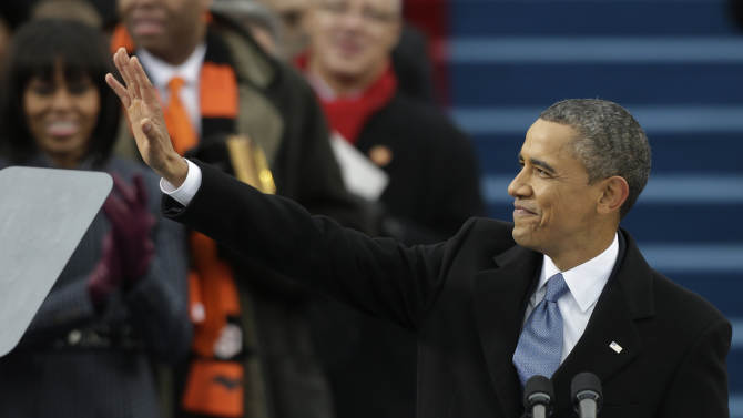 President Barack Obama waves after his ceremonial swearing-in at the U.S. Capitol during the 57th Presidential Inauguration in Washington, Monday, Jan. 21, 2013. (AP Photo/Pablo Martinez Monsivais)