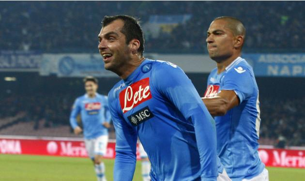 Napoli's Pandev celebrates with his team mate Inler after scoring against Udinese during their Italian Serie A soccer match at San Paolo stadium in Naples