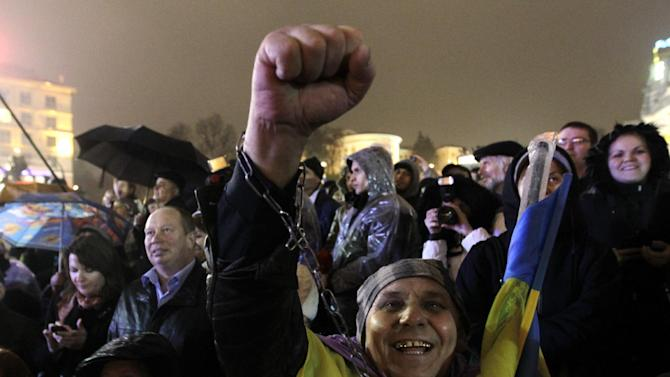 Activists shout slogans during a rally in support of Ukraine's integration with the European Union in the center of Kiev, Ukraine, Friday, Nov. 22, 2013.(AP Photo/Sergei Chuzavkov)