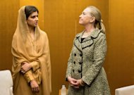 US Secretary of State Hillary Clinton (R) and Pakistan Foreign Minister Hina Rabbani Khar (L) wait for the start of their bilateral meeting at the Prince Park Tower Hotel Center in Tokyo on July 8. Clinton said Sunday that the United States and Pakistan are putting past tensions behind them to focus on the future, after meeting with her Pakistani counterpart
