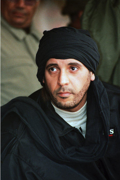 In this undated photo made available Sept. 25, 2011, Hannibal Gadhafi, son of the recently ousted Libyan leader Moammar Gadhafi, watches an elite military unit exercise in Zlitan, Libya. Kamal Mortada