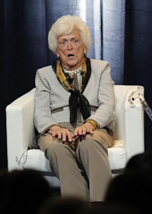 """Former first lady Barbara Bush tells a story during a panel that was part of the conference """"America's First Ladies: An Enduring Vision,""""  at SMU in Dallas, Monday, March 5, 2012.  (AP Photo/LM Otero)"""