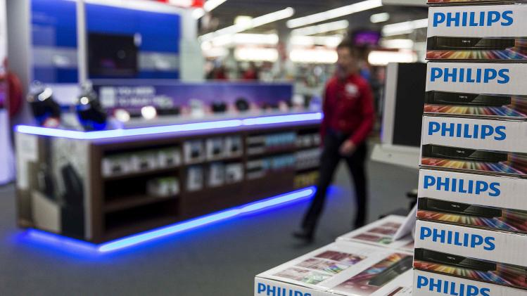 A stack of Philips DVD recorders are displayed in a household items store in Utrecht