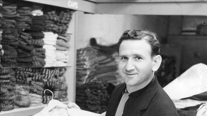 In this 1957 photo provided courtesy of the Bernard J. Lansky Collection, clothier Bernard Lansky displays a jacket in his high-fashion store in Memphis, Tenn. Lansky, known as the clothier to rock and roll icon Elvis Presley, died Thursday, Nov. 15, 2012 at age 85 in Memphis. (AP Photo/Courtesy of the Bernard J. Lansky Collection) MANDATORY CREDIT