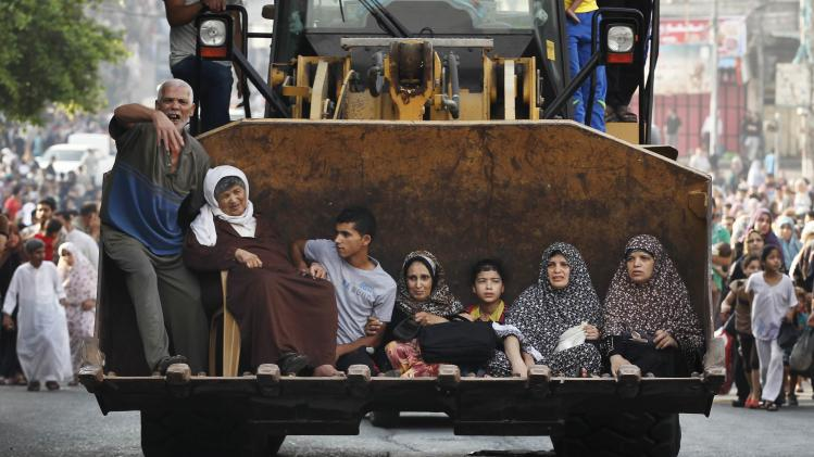 Palestinian families flee the Shujayeh neighbourhood during heavy Israeli shelling in Gaza City
