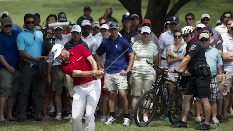 Keegan Bradley hits from off the fairway onto the 11th green during the final round of the Byron Nelson golf tournament on Sunday, May 19, 2013, in Irving, Texas. Bradley finished two strokes behind tournament champion Sang-Moon Bae. (AP Photo/Tony Gutierrez)