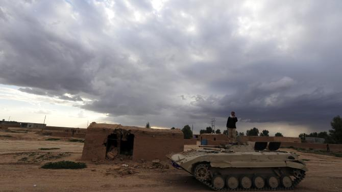 A soldier stand on top of a tank in the town of Hamrin in Salahuddin province