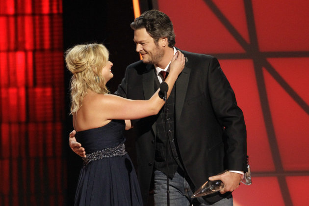 Miranda Lambert, left, and Blake Shelton embrace onstage after winning the award for song of the year for &quot;Over You&quot; at the 46th Annual Country Music Awards at the Bridgestone Arena on Thursday, Nov. 1, 2012, in Nashville, Tenn. (Photo by Wade Payne/Invision/AP)