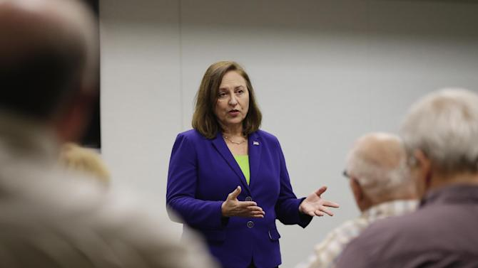 In this photo from April 29, 2013, Sen. Deb Fischer, R-Neb., gestures during a town meeting in Nebraska City, Neb., Monday, April 29, 2013. Fischer's opposition to a pathway to citizenship for people in the country illegally resounds loudly with her rural Nebraska constituents, yet clashes with calls from Republicans elsewhere for compromise. (AP Photo/Nati Harnik)